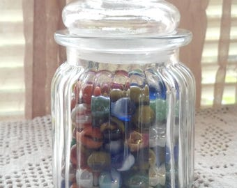 Medium Glass Jar with Lid full of Marbles