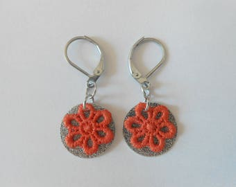 Earrings with spangled sequins and hand-painted orange lace flowers.