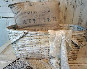 Distressed white basket large shabby cottage chic chippy painted oval wood bottom handles French Nordic farmhouse decor anita spero design