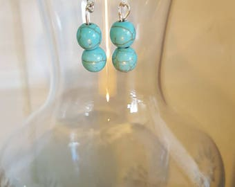 Blue stone drop earrings.