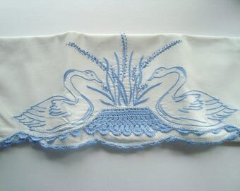 Vintage embroidered white pillowcase with blue embroidery
