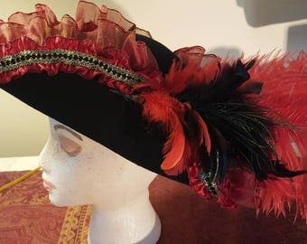 Black wool tricorn with red ruffles and black/gold trim