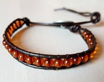 Bracelet Plume de Coton en cuir marron et perles d'ambre