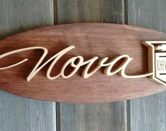 1965 Chevrolet Nova Emblem Oval Wall Plaque-Unique scroll saw automotive art created from wood.