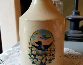 Vintage Victorian pot with blue bird decal