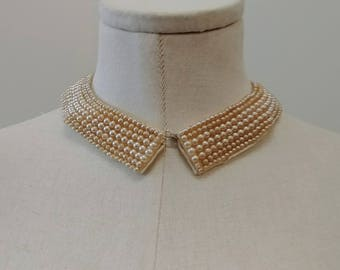 "1950's Vintage Cream Beaded Pearl Collar with Cream satin backing  Made in Japan  1"" wide by 16"" in length  1 hook closure"