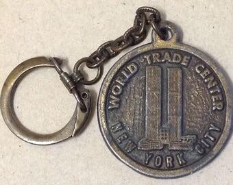 World Trade Center 1980's NYC Souvenir WTC New York City The Big Apple brass vintage street tourist medallion fob key chain USA