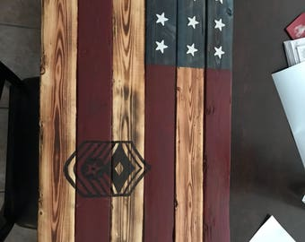 Flag wall hanging with burnt logo