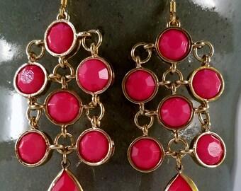 Pink chandelier dangle earrings.