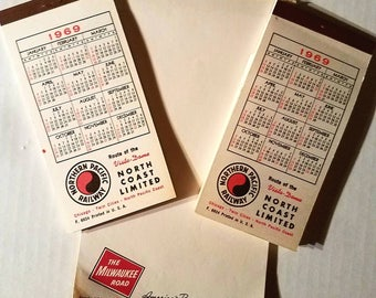Three vintage Northern Pacific Railway and Milwaukee Road railroad notepads. 1969 calendar. Train collectibles. North Coast Limited.