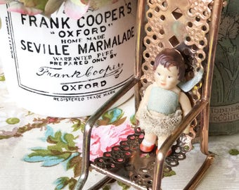 A lovely little doll's house rocking chair
