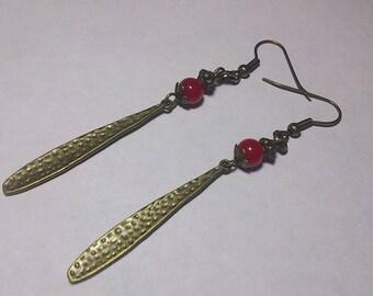 Bronze drop earrings, red glass beads
