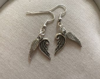 Double wing silver coloured earrings end of line