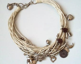 Cotton necklace with charms