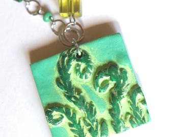 Green Fiddlehead polymer clay pendant necklace original art by Cortney Rector Designs