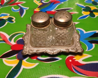 Vintage glass small square salt and pepper shakers with metal lids and tray