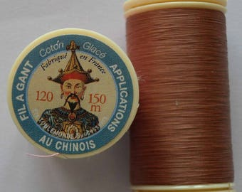 Spool of thread color 217 puppet