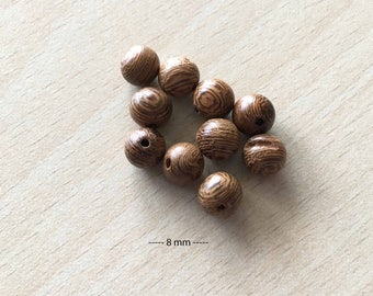 """Bag of """"wing"""" wooden beads size 8 mm"""
