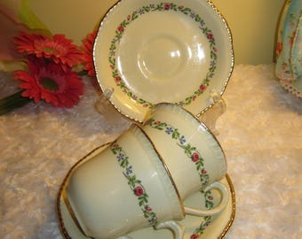 RIDGWAY, Staffordshire, pair cups saucers, 22 KT gold decoration, rose floral, cream background, great condition, mailed from Canada