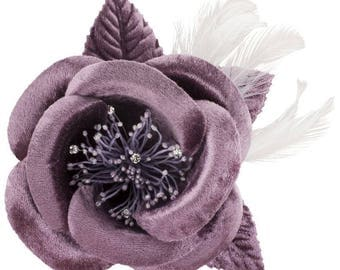 Purple feathers and satin flower