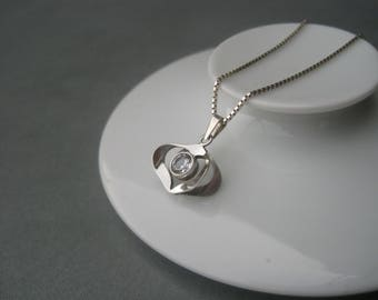 Romantic small 3D silver heart pendant decorated with faceted rock crystal. Salovaara, Finland.