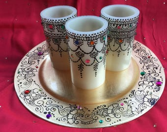 Beautifully decorated  candles with henna and crystal