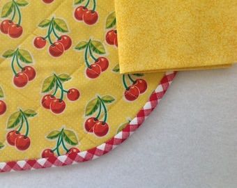 Quilted placemats In a happy yellow and red cherry print, set of 2