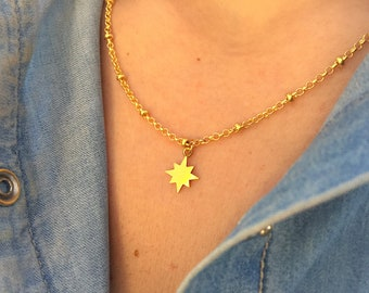 Necklaces with steel chain with beads and polar star pendant