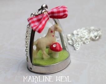 pretty Unicorn and red mushroom globe necklace