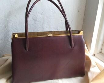 Vintage 50s 60s brown leatherette frame handbag. Metal frame.
