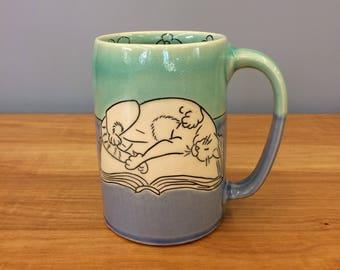 Handmade Mug with Sleeping Cat and Book. Glazed in Aqua & Blue. MA43