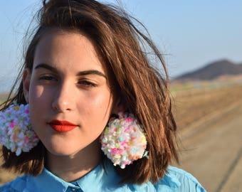 Large pom pom earrings