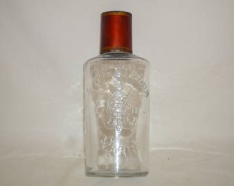 """Antique 1800s French Glass Bottle """"Au Printemps Paris"""" = Spring Store Paris with relief Label and original Tole Cap lid"""