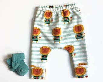 Baby infant lion pants. Slim fit harem pants with cuffs. white sweat fabric with green stripes. Infant sweat pants. Bbaby leggings