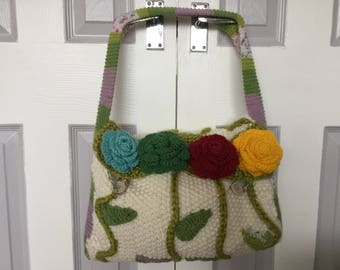 Hand knitted shoulder handbag.