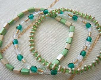 Emerald trio bracelets worn together or separately