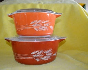 Vintage Pyrex casserole dishes with lids Autumn Harvest Wheat pattern set of two Vintage Pyrex Casseroles with lids Burnt orange and rust