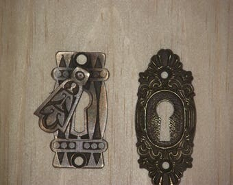 Four antique brass escutcheons from the very early 1900's.
