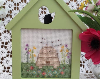 Cross stitch of a bee hive