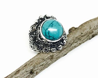 Turquoise ring set in sterling silver 92.5. Size -7.  Authentic turquoise stone. Detailed silver work