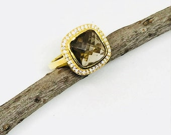 10% Smokey Topaz and white topaz ring set in sterling silver gold vermeil.Size -7,8Natural stones.