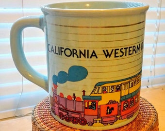 Vintage 'California' mug with trains, gold and a skunk.