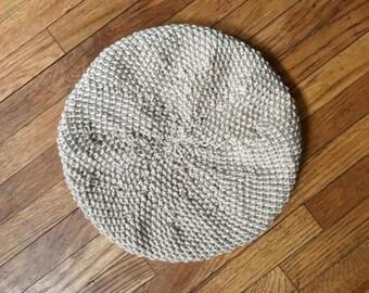 Women's beige knitted beret hat