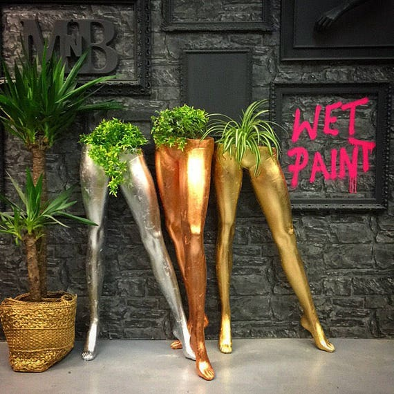 Upcycled female mannequin leg indoor planter
