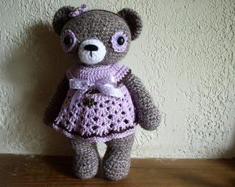 little teddy bear crochet with her purple dress