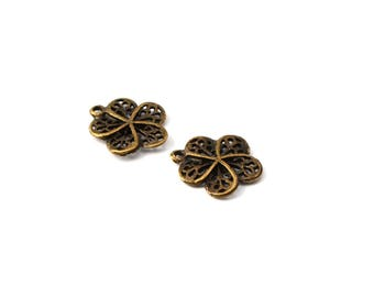 Sold by 2 antique brass flower charms