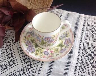 Demitasse cup and saucer . Royal Albert