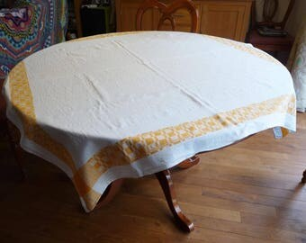 """Vintage damask weave white cotton table cloth with yellow woven border. Measures 51"""" (130 cm) square. With CC41 utulity mark."""