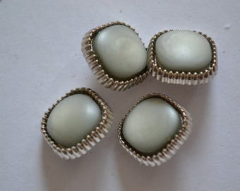 set of silver fancy buttons