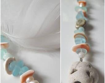 Shell, Sea Glass, Aquamarine, Freshwater Pearl, Hag/Holy Stone, and Swan Feather Talisman